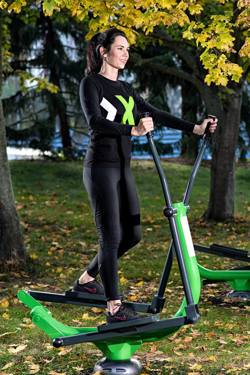 Woman Using Cross Trainer